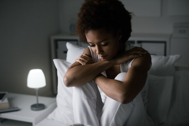 worried woman in bed